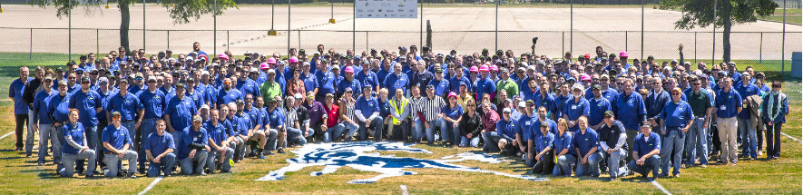 Ewing Irrigation employees panorama on football field