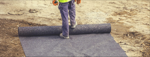 A geotextile roll being unrolled