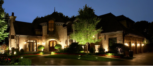 Large house with circular driveway and pathlighting