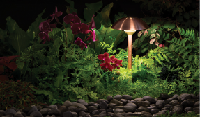 LED copper path light in planter bed
