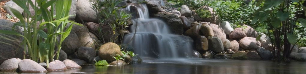 A small waterfall flowing into a pond