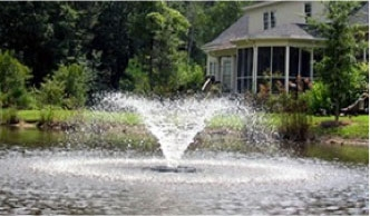 An aerator spraying in a pond