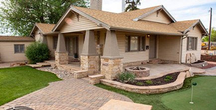 Backyard with pavers and grass