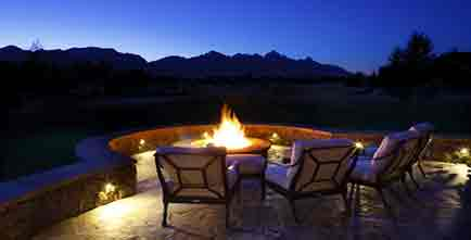 Patio chairs surrounding a fire pit
