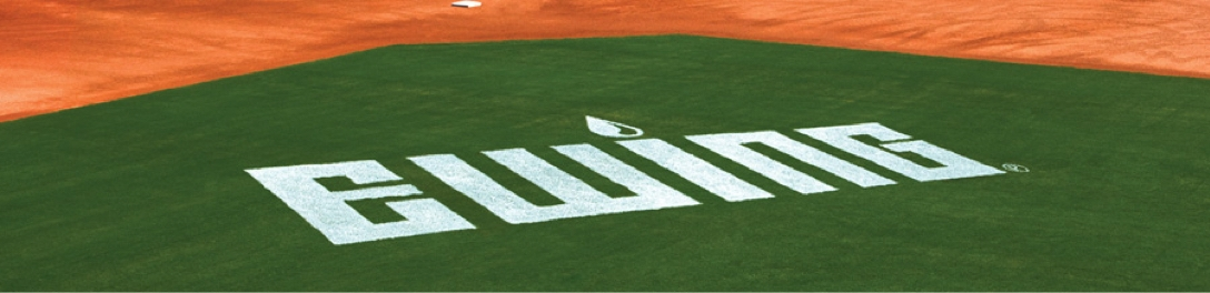 A baseball field with the Ewing logo