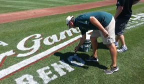 A baseball field being painted