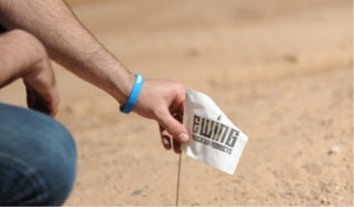 A small Ewing flag being placed